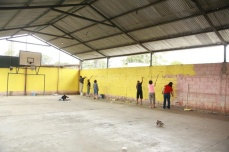 A team of women paints the gym in one day